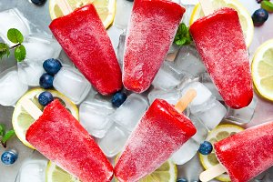 frozen strawberry juice snack ice pop or popsicle on a white mar
