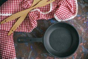 empty black cast-iron frying pan