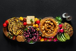 Vegan snack board. Flat-lay of Various Vegetarian dishes  hummus