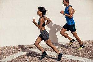 Two runners running outdoors