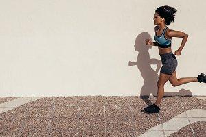 Healthy woman athlete running