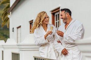 Beautiful couple in bathrobe