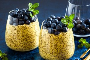 Chia seed and mango puree pudding with berries blueberry and min