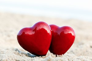 Two red hearts on the beach