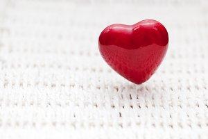 Red heart shape on wicker