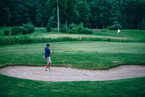 Chip Shot Played by a Golf Player.