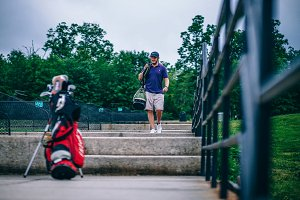 Golfer with Golf Clubs Bag
