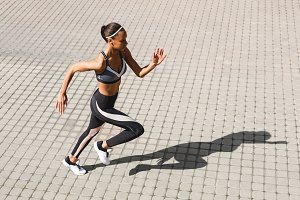 Female runner sprinting in the city