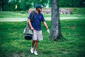 Golfer Looking Away at Golf Field