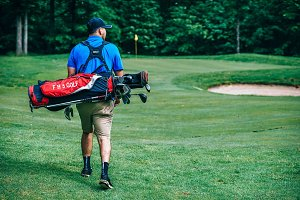 Golfer Carrying Golf Bag