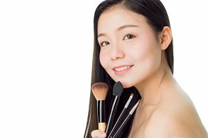 woman hold the blush brush and smile. skin beauty and health, for spa products and make up. The skin is smooth and beautiful. concept of healthy women, on white background.