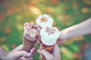 Women hand holding an ice cream.