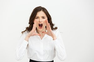 Business Concept: Closeup portrait of a businesswoman yelling isolated on white background