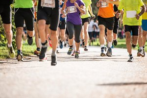 Group of unrecognizable runners outdoors. Long distance running.