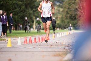 Unrecognizable runner outdoors. Long distance running.