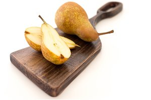 Pear is not a chopping board. Isolate the pears on the board.