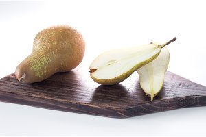 Piece of pears on a chopping board. Isolate.