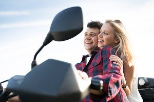 Couple in love enjoying a quad bike ride in countryside.