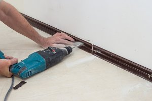 Fixing the skirting Board to the wal