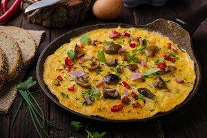 Fresh omelette, pickles mushrooms and chilli