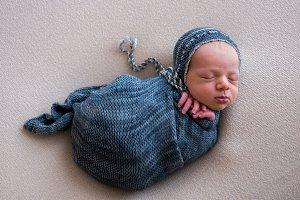 newborn in a crib