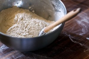 Flour in a bowl with a spatula on a
