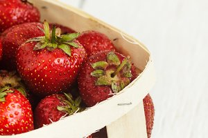 Delicious ripe strawberry in wooden