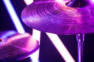 drum cymbal close-up, on a background of colored lanterns.