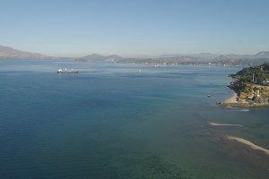 Sea bay with cargo ships.