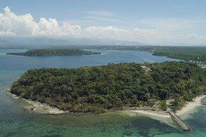 Tropical island Magalawa with beach.