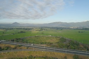Tropical landscape with highway, farmer fields in the Philippines.