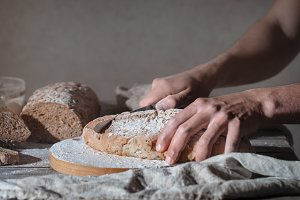 baker holding fresh bread in hands