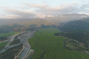 Tropical landscape mountain valley with villages and farmlands.