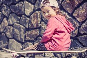 little girl fell on skateboarding