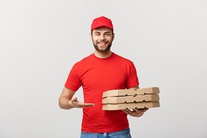 Delivery Concept: Portrait of Pizza delivery man presenting something in box. Isolated white background.