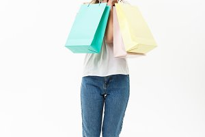 Full length of Shopper woman holding shopping bags standing happy smiling and excited in full body isolated on white background.