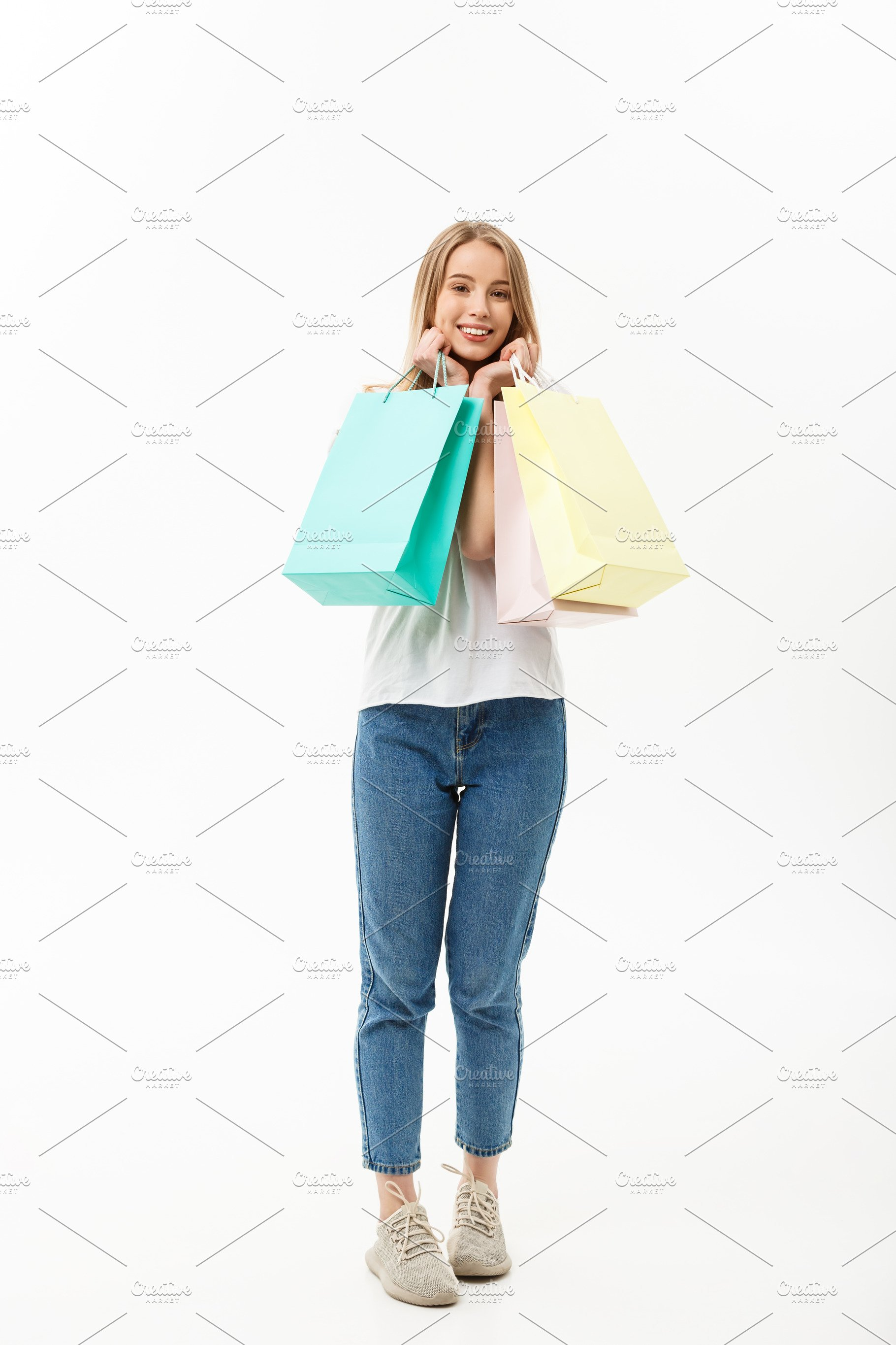 975523f73dbd7 Full length of Shopper woman holding shopping bags standing happy ...