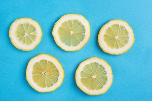 Sliced lemon on blue background