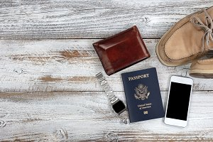 Travel objects on faded white wood