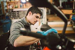 Mechanic polishing a motorbike