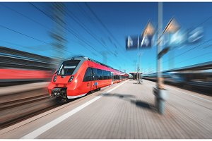 High speed red train in motion on the railway station