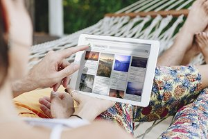 Couple using a tablet (PSD)