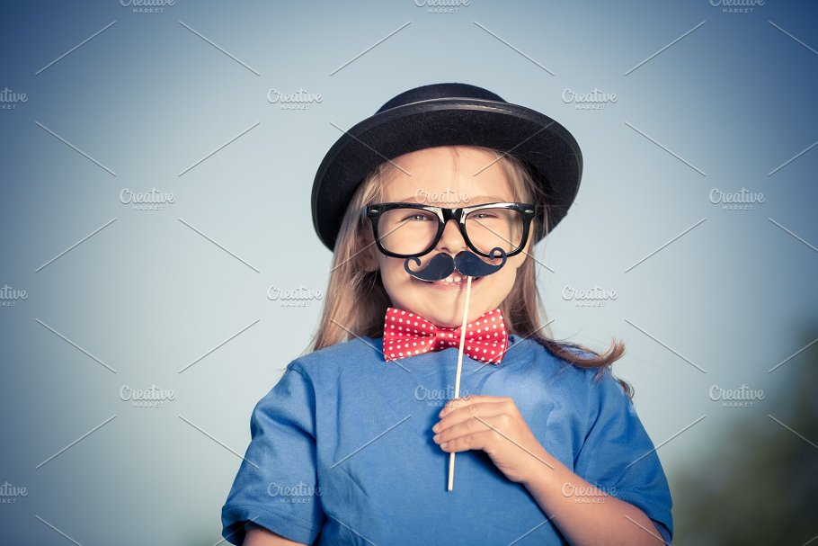 18c64504a8ed Funny happy little girl in bow tie and bowler hat. - People. Outdoor  portrait ...
