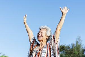 Senior woman raising her hands