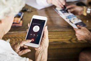 Senior woman using her phone (PSD)