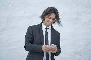 Handsome guy with suit and mobile ph