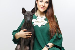 woman with thai ridgeback puppy
