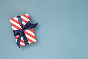Gift box with blue ribbon.