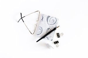 Notepad, glasses, calligraphy pen