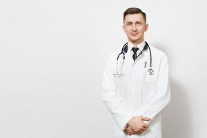 Serious confident experienced handsome young doctor man isolated on white background. Male doctor in medical gown, shirt and tie, stethoscope looking camera. Healthcare personnel, medicine concept.